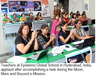 Teachers at Epistemo Global School in Hyderabad, India, applaud after accomplishing a task during the Moon, Mars and Beyond e-Mission.